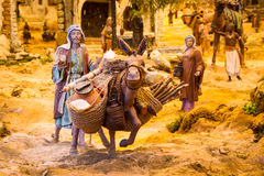 Man with a donkey in a creche. Man with a donkey in a Christmas creche stock photography