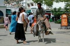 Man on Donkey, Market, Moulay Idriss Zerhoun, Morocco Stock Photo