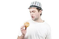 Man with a donut in his hand Stock Photography