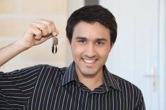 Man with a doorkey Stock Images