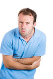 man doubling over in stomach pain Stock Photography