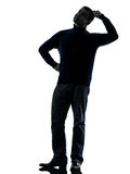 Man doubtful thinking silhouette full length Royalty Free Stock Photos