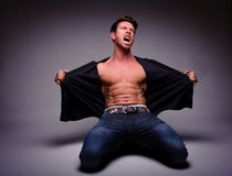 Man down on his knees expressing anger Royalty Free Stock Photo
