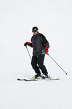 Man downhill skiing. Portrait of man downhill skiing stock photo