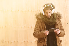 Man downloading music in instagram style Royalty Free Stock Photos