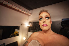 Man in Drag in Dressing Room. Serious male in drag waiting in dressing room Royalty Free Stock Image