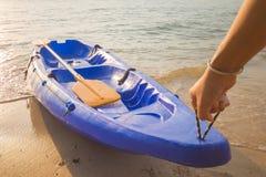 Man dragged the kayak up on shore Stock Image