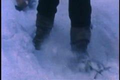 Man dragging log through the snow stock footage