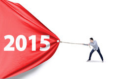 Man dragging number 2015 in studio Stock Photos