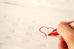 Man draw a heart shape in the calendar Stock Photos