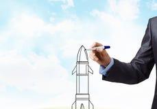 Man draw rocket Stock Photo