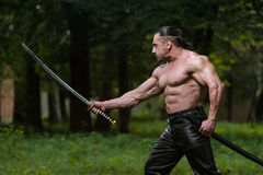 Man Drawing Ancient Sword In Self Defense Royalty Free Stock Images