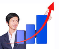 Man drawing arrow up graphs Royalty Free Stock Photography