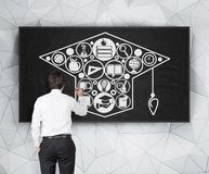 Man drawing bachelor cap Stock Image