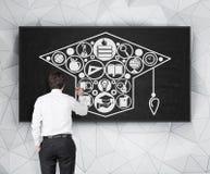 Man drawing bachelor cap Stock Image