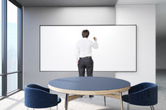Man drawing on blank poster. On wall. 3d rendering Stock Images