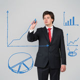 Man drawing blue graphic Stock Image