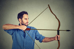Man drawing a bow Stock Photo