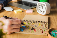 Man drawing business charts Stock Images