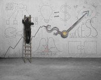 Man drawing business concept doodles on wall. With clock hands Royalty Free Stock Images
