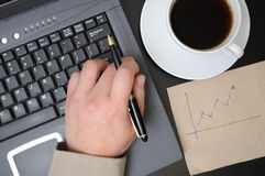 Man drawing business finance graphs. In office Stock Images