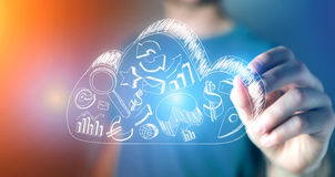 Man drawing business icons on a cloud on a technology futuristic Stock Photos