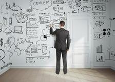 Man drawing business plan Stock Image