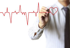 Man drawing chart heartbeat. Man drawing heart and chart heartbeat Royalty Free Stock Photos