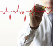 Man drawing chart heartbeat Stock Image