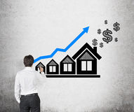 Man drawing chart and house Stock Images