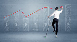 Man drawing chart from ladder Royalty Free Stock Photo