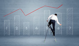 Man drawing chart from ladder Stock Photos