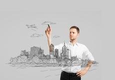 Man drawing city Stock Photos