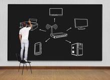 Man drawing computer network Royalty Free Stock Photo