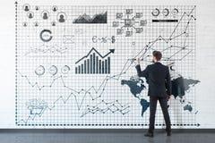 Man drawing diagrams Stock Photo