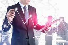 Man drawing digital graph. Trading stock images