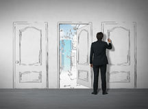 Man drawing a door with a marker Royalty Free Stock Photos