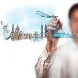 Man drawing the dream travel arounf the world. A man drawing the dream travel around the world on whiteboard Royalty Free Stock Image