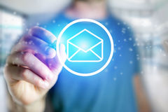 Man drawing an email icon on a futuristic interface - Technology. View of a Man drawing an email icon on a futuristic interface - Technology concept Royalty Free Stock Images