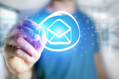 Man drawing an email icon on a futuristic interface - Technology Stock Photography