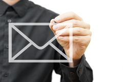 Man drawing email icon on virtual screen. Contact information. Concept stock photos