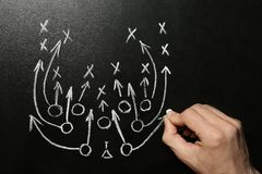 Man drawing football game scheme on chalkboard. Top view royalty free stock photos