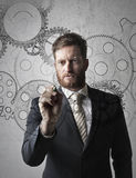 Man drawing gears Royalty Free Stock Photo