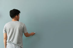 Man drawing gesture with white chalk on chalkboard or wall. Stock Photos
