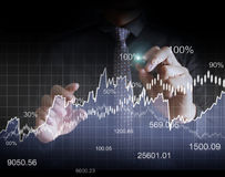 Man drawing a growing graph Royalty Free Stock Photos