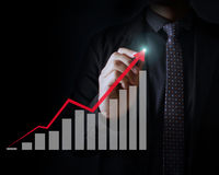 Man drawing a growing graph Royalty Free Stock Photography