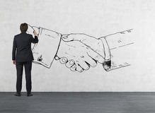 Man drawing handshake Stock Photo