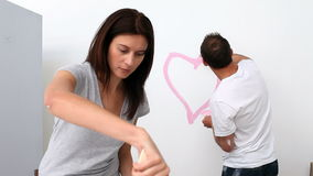 Man drawing a heart on the wall Stock Images