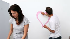 Man drawing a heart on the wall Royalty Free Stock Image