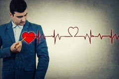 Man drawing heartbeat Stock Images